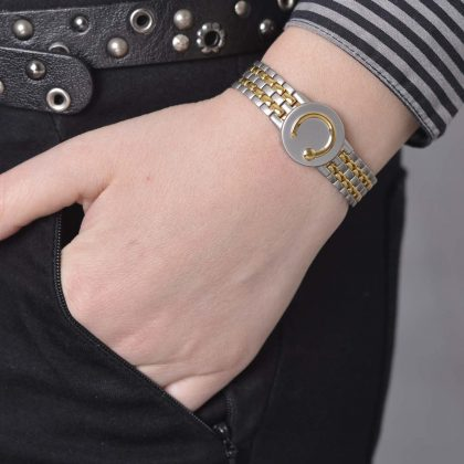 lady wearing a gold and stainless steel elite two toned