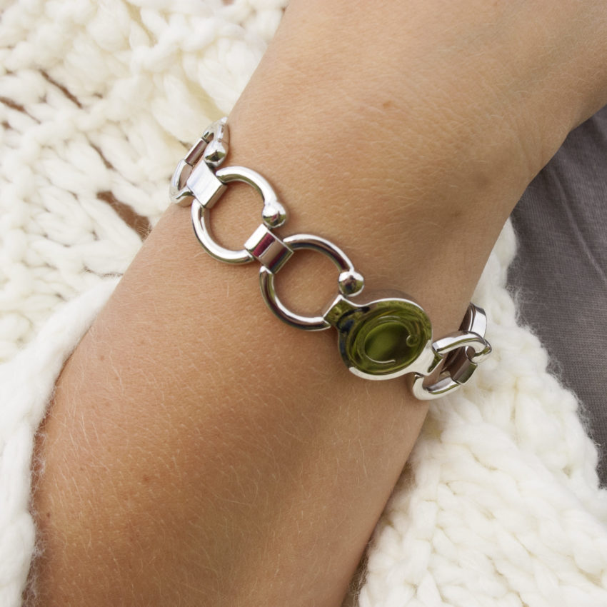 Woman wearing a polished stainless steal pirouette Bioflow Bracelet