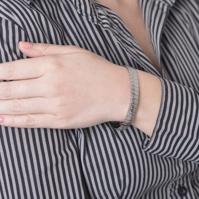 Woman wearing Lux Polished finish magnetic bracelet