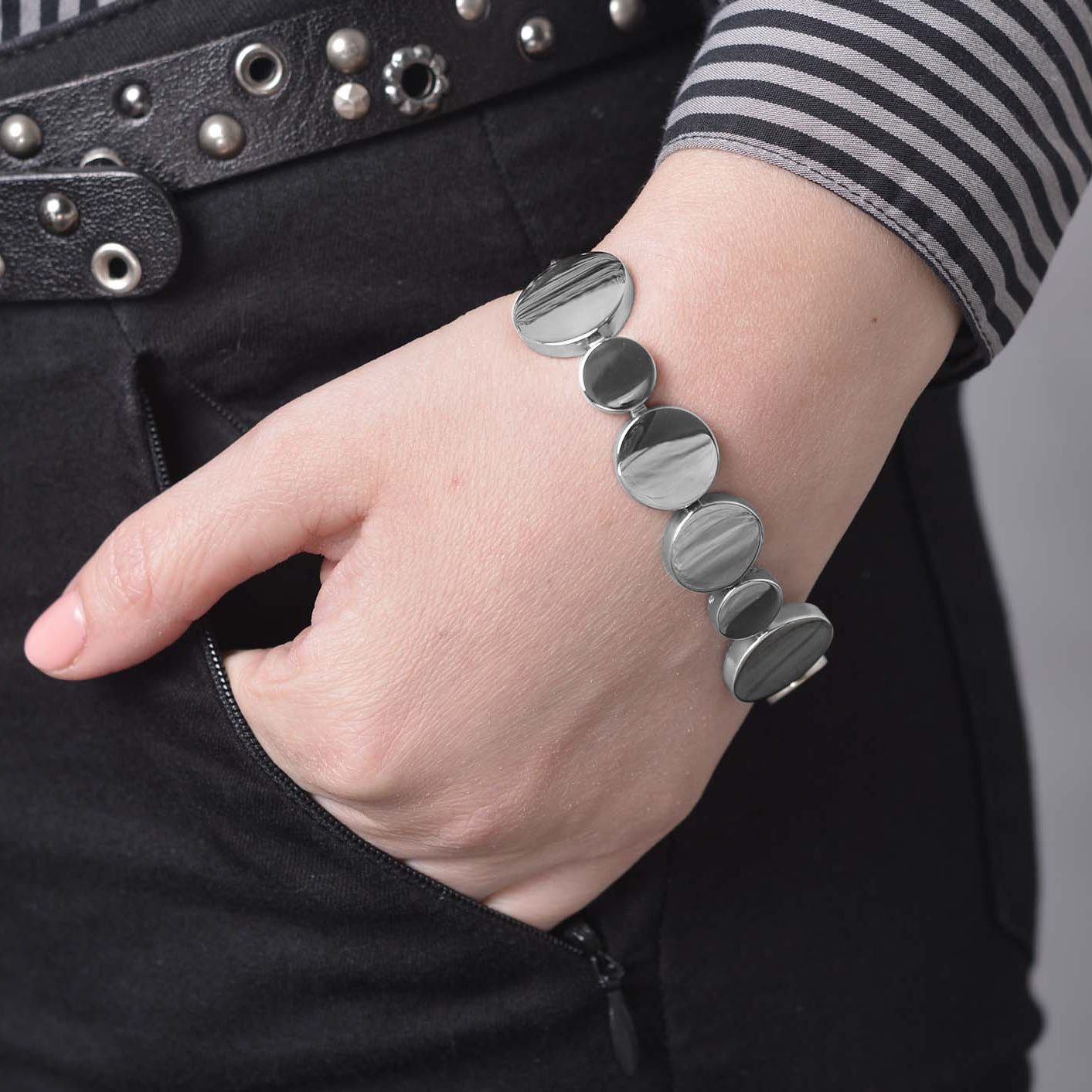 lady wearing a polished stAinless steel eclipse